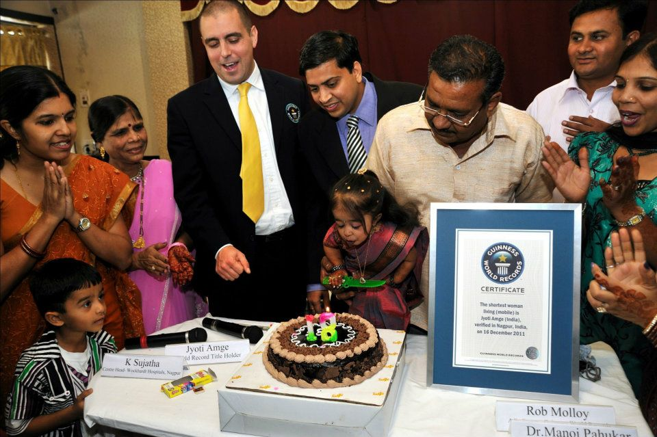 Jyoti Amge blows out the candles on her th birthday cake.Photo Credit: Ashesh Shah/Guinness World Records