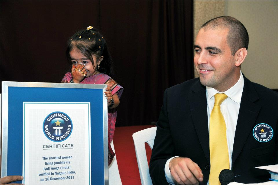 Jyoti Amge wipes a tear from her eye after receiving her official Guinness World Records certificate.Photo Credit: Ashesh Shah/Guinness World Records