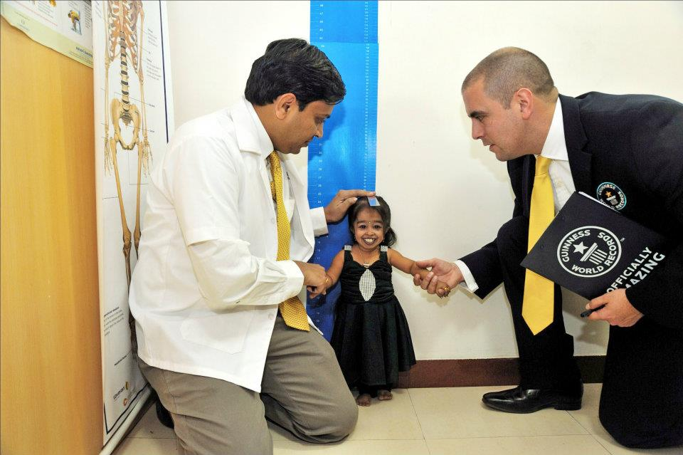 Jyoti Amge has her height measured in her home town of Nagpur, India. She was measured  times, both standing up and lying down, over a  hour period.Photo Credit: Ashesh Shah/Guinness World Records