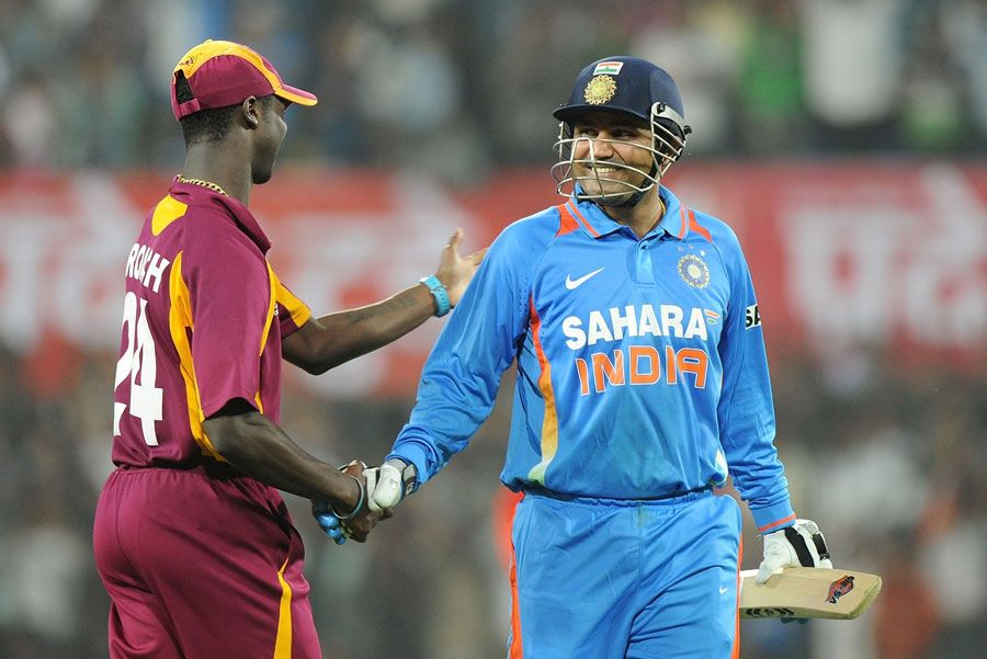 Virender Sehwag congratulated by a West Indies player