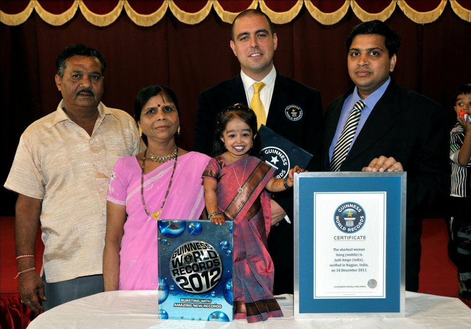 Jyoti Amge poses at a press conference with her parents, Guinness World Records adjudicator Rob Molloy, and the local doctor who measured her height.Photo Credit: Ashesh Shah/Guinness World Records