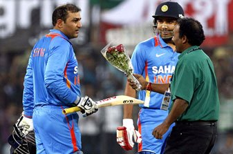 Virender Sehwag congratulated by a fan