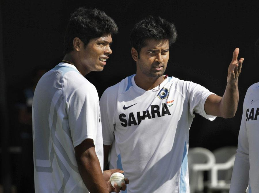 Umesh Yadav discusses with Vinay Kumar during the practice session. -Team Umesh