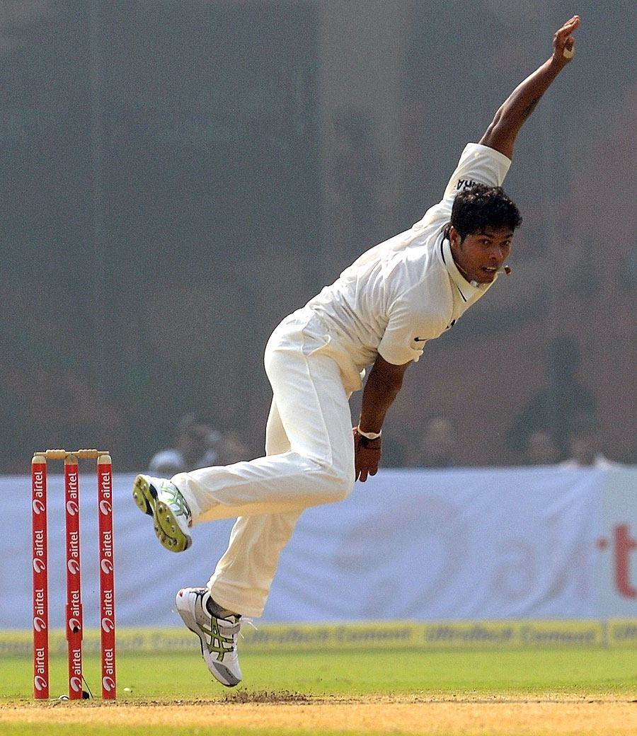 Umesh Yadav bowls on Test debut today against West Indies at Ferozshah Kotla, Delhi. - Team Umesh