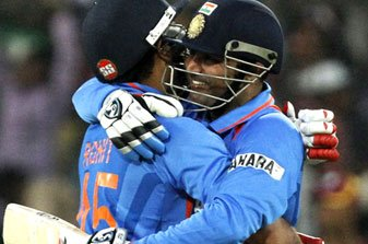 Virender Sehwag hugs Rohit Sharma after completing 200 runs