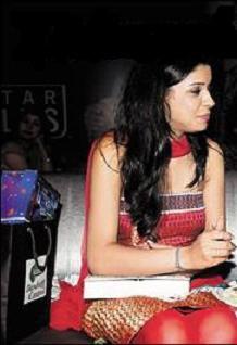 In Red Chudidar Salwar Suit