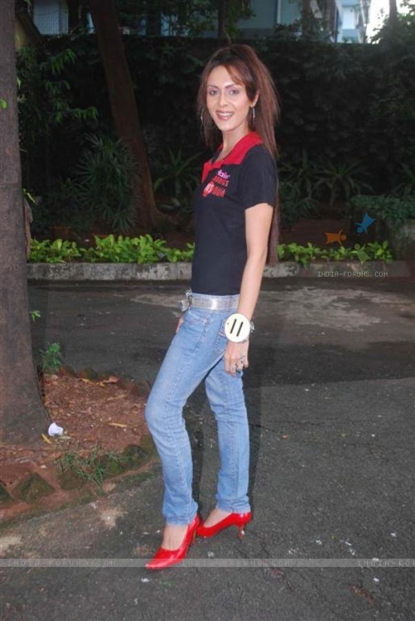 In Blue Jeans,Black T-Shirt with Red Coaler and Red Shoos