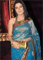 In Sky Blue Saree With Golden Hand Purse