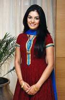 In Maroon Salwar Suit With Blue Dupatta