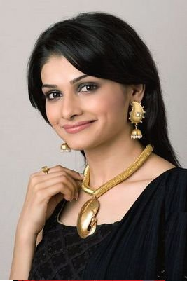 In Black Dress With Gold Jewellery's