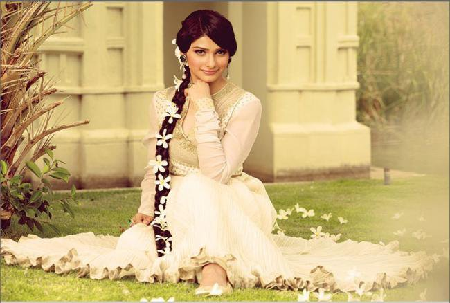 In White Anarkali Pattern Salwar Sitting At Garden Area