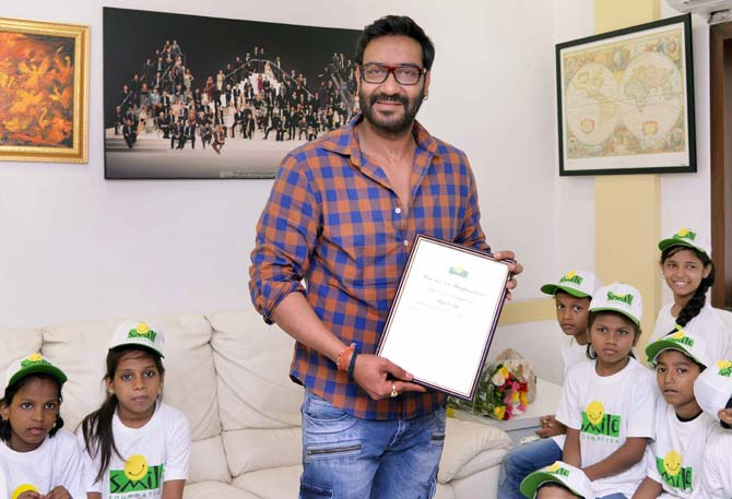Ajay Devgan meets underprivileged children on Father's Day