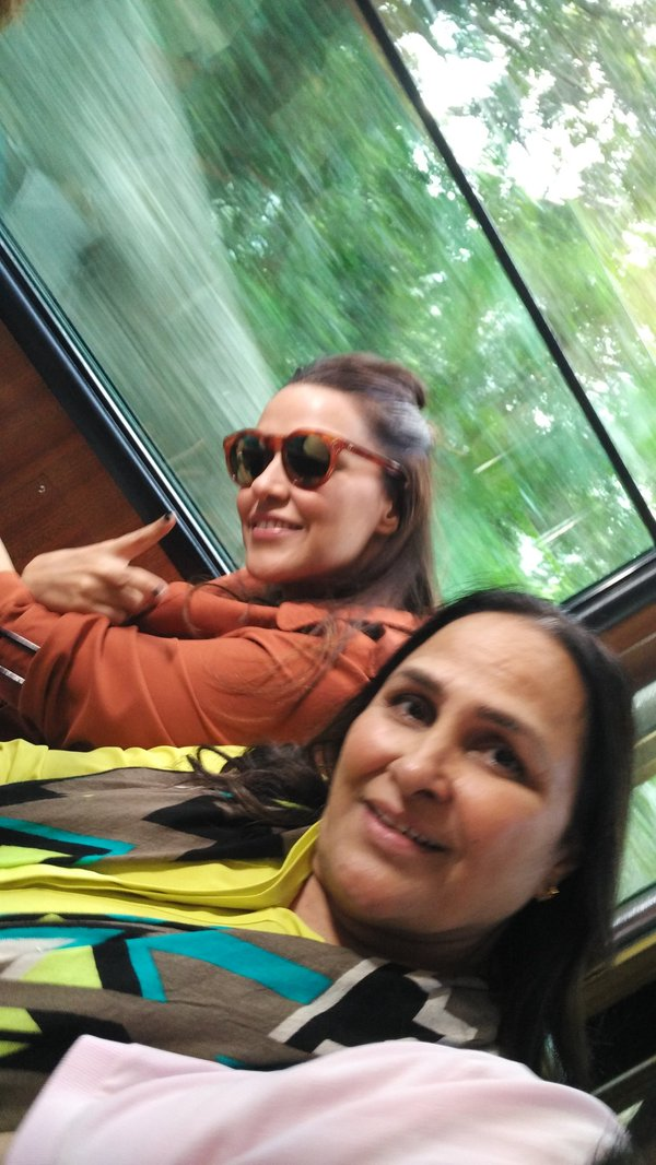 Neha Dhupia Enjoys Her Peak Tram Ride with Her Parents