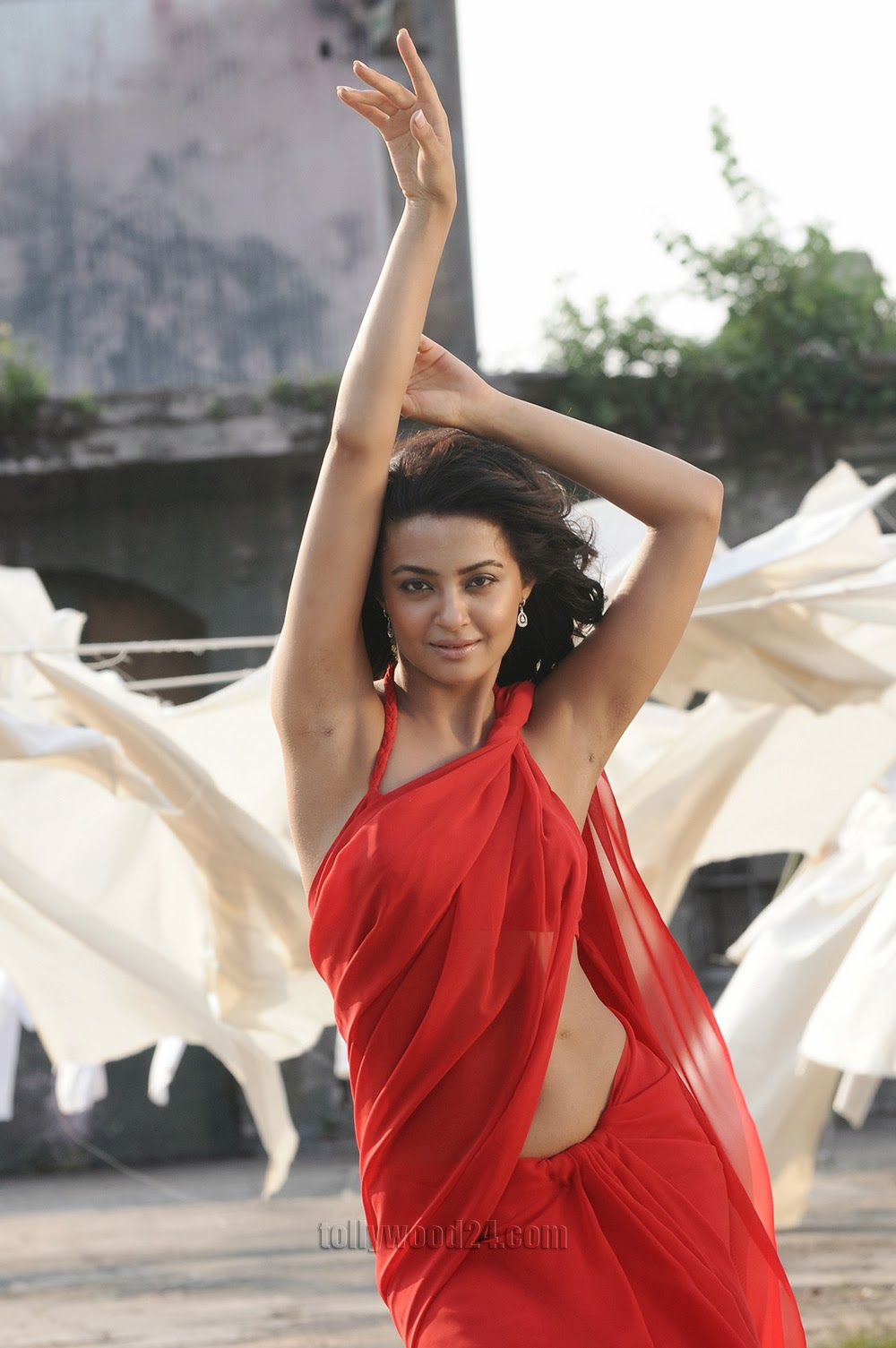 Surveen Chawla Hot Photos in Red Saree from Itlu Prematho Movie